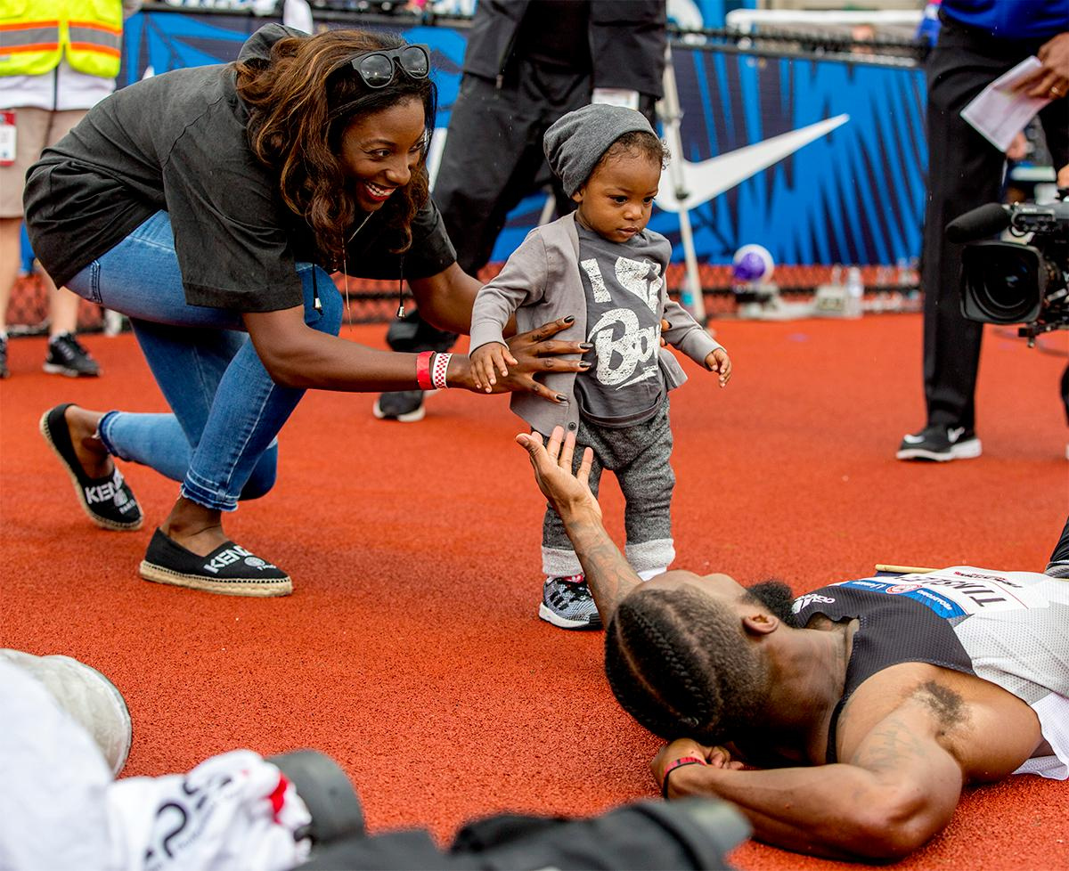 Adidas Michael Tinsley greets his family after finishing third in the 400 meter final in a time of 48.82. Photo by August Frank, Oregon News Lab
