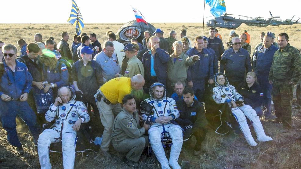 Happy landings: 3 space station crew members back on Earth ...