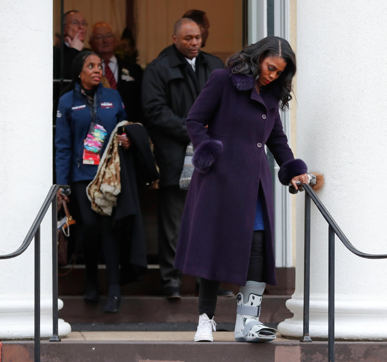 Omarosa Manigault walks down the stairs after attending church service at St. John's Episcopal Church across from the White House in Washington, Friday, Jan. 20, 2017. (AP Photo/Pablo Martinez Monsivais)
