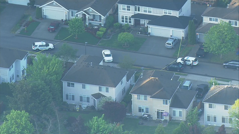 Police respond to a double shooting at a home in University Place (KOMO Photo)