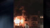 Video shows people ready to jump from balcony to escape apartment fire