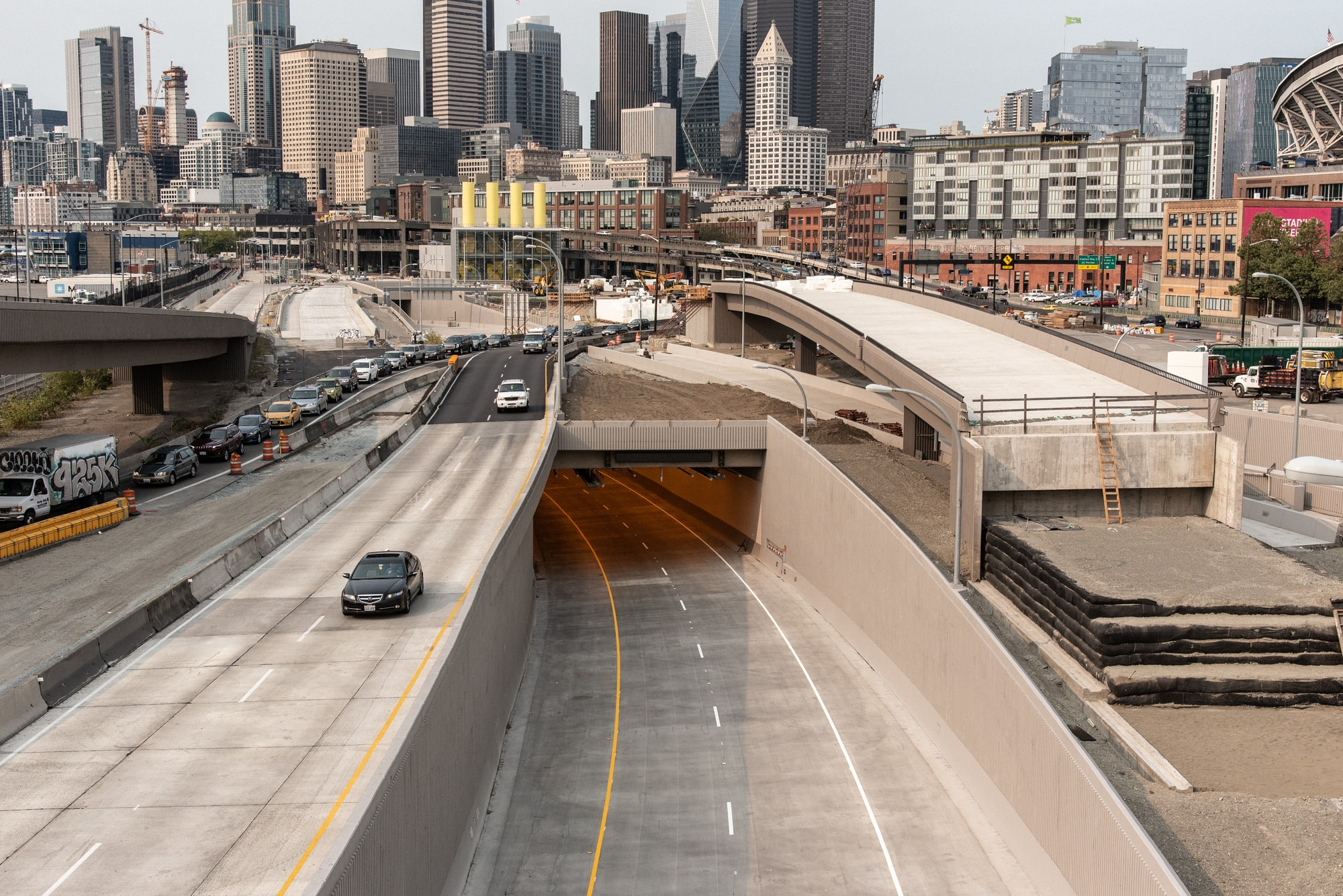 Workers paint the lane stripes on the SR99 Waterfront Tunnel (Photo: WSDOT)