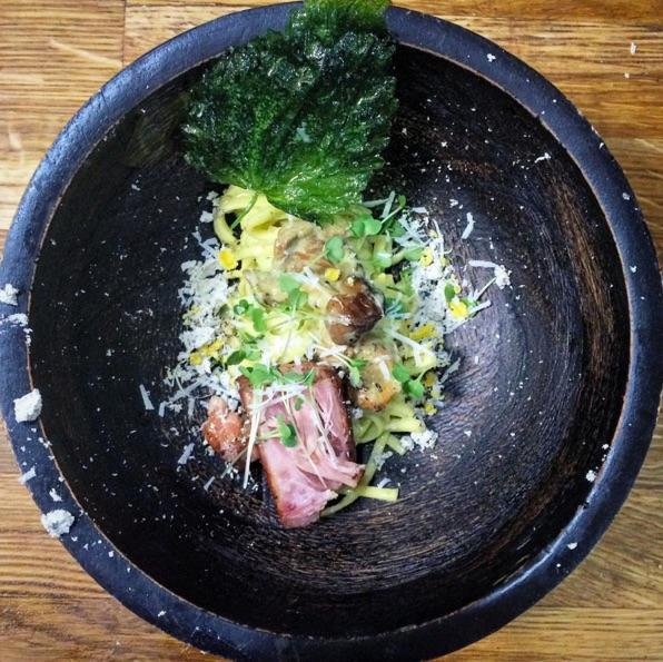 Smoked oyster and stinging nettle carbonara, cured duck yolk, cider pork belly confit, pecorino, pork fat and nettle crisp, garden of eden arugula babies. (Image: @maximillianpetty / Instagram)