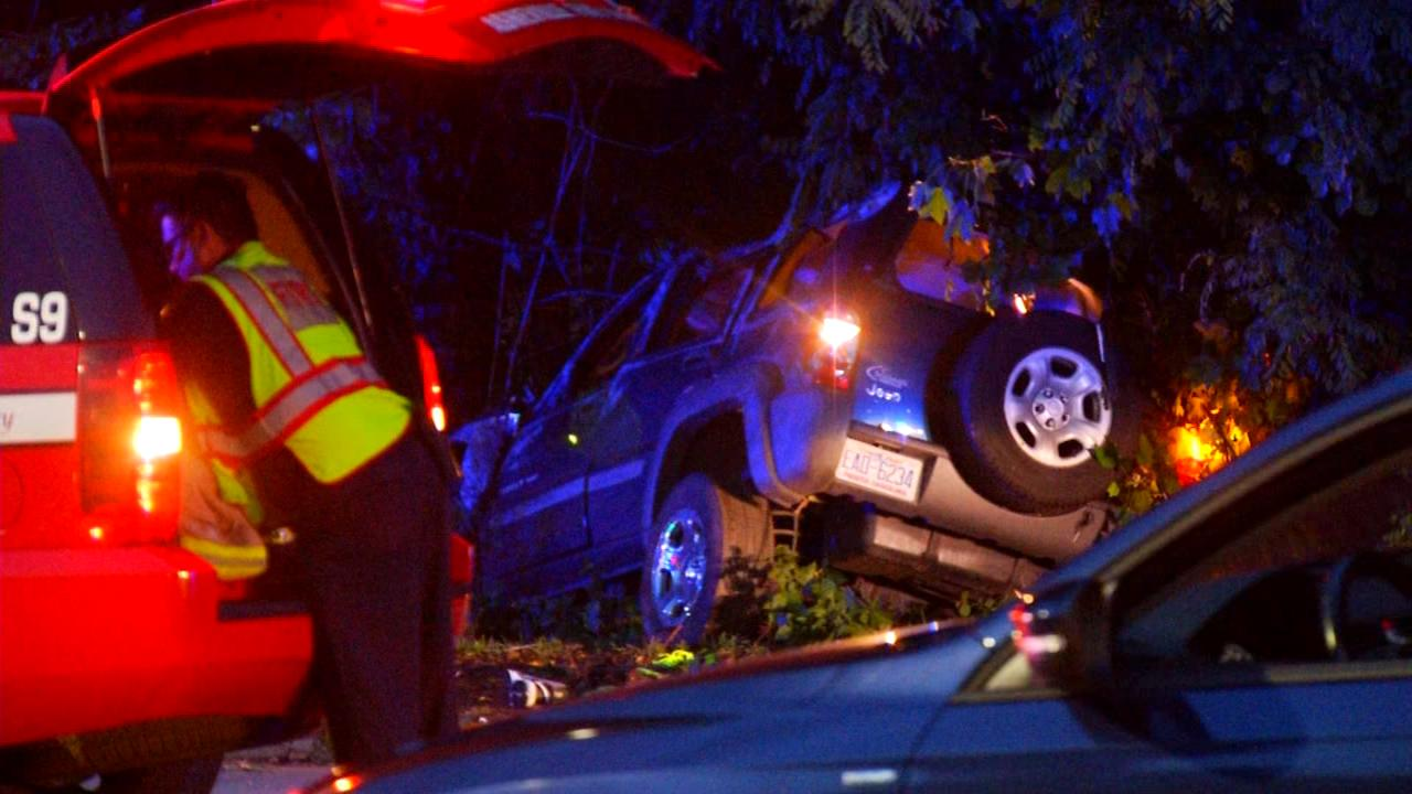 The scene at hit and run on Monday night along Tunnel Road.  Officials say the driver hit another vehicle and nearly went into Haw Creek. (Photo credit: WLOS staff)