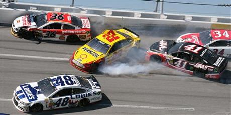 Joey Logano (22) collides with Reed Sorenson (36) as Kurt Busch (41) and David Ragan (34) and Jimmie Johnson (48) move through Turn 4 during the Aaron's 499 Sprint Cup series auto race at Talladega Superspeedway, May 4, 2014.