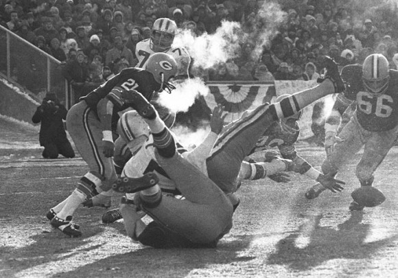 Players spill in all directions as a fumble occurs in the third quarter of the NFL Championship Game, Dec. 31, 1967, at Lambeau Field. Dallas quarterback Don Meredith (white jersey, #17) fumbles and Herb Adderley of the Packers (#26, partially hidden) reaches to recover it in the game played in sub-zero temperatures. (AP Photo/File)