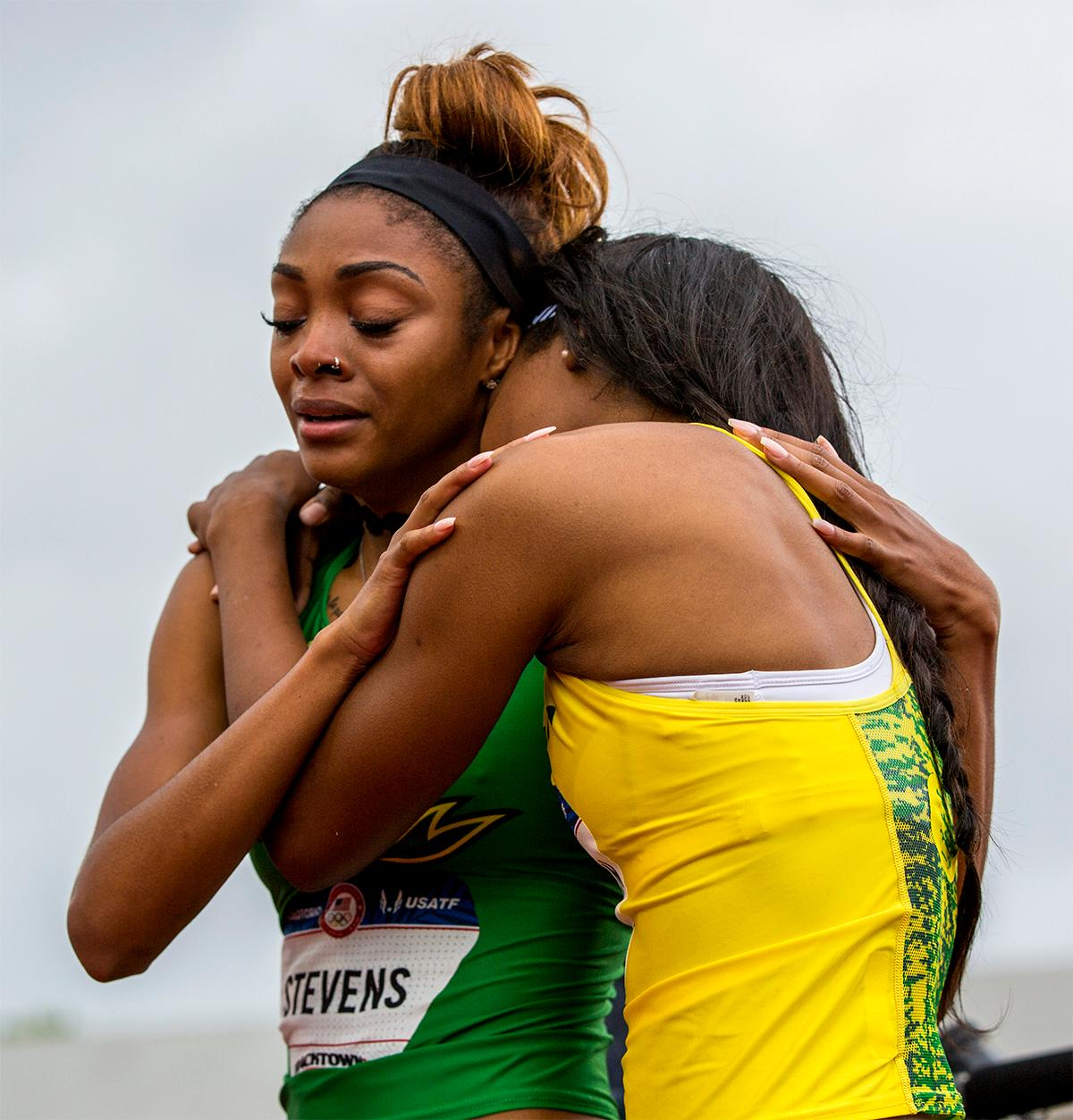 Oregon's Deajah Stevens is congratulated by teammate Arianna Washington after finishing second in the 200 meter in a time of 22.30 and punching her ticket for Rio. Photo by August Frank, Oregon News Lab