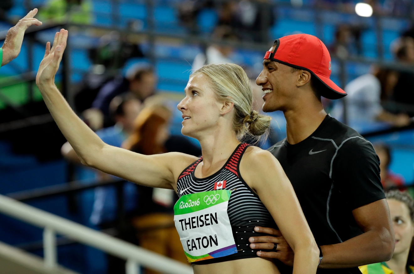 Canada's Brianne Theisen Eaton is greeted by husband Ashton Eaton after the women's heptathlon 800-meter heat during the athletics competitions of the 2016 Summer Olympics at the Olympic stadium in Rio de Janeiro, Brazil, Saturday, Aug. 13, 2016. (AP Photo/David J. Phillip)
