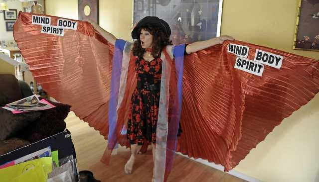 Andy Atkinson / Daily Tidings Janai Mestrovich, aka Grandma Boom, shows off a set of her fairy wings she wears while teaching children.
