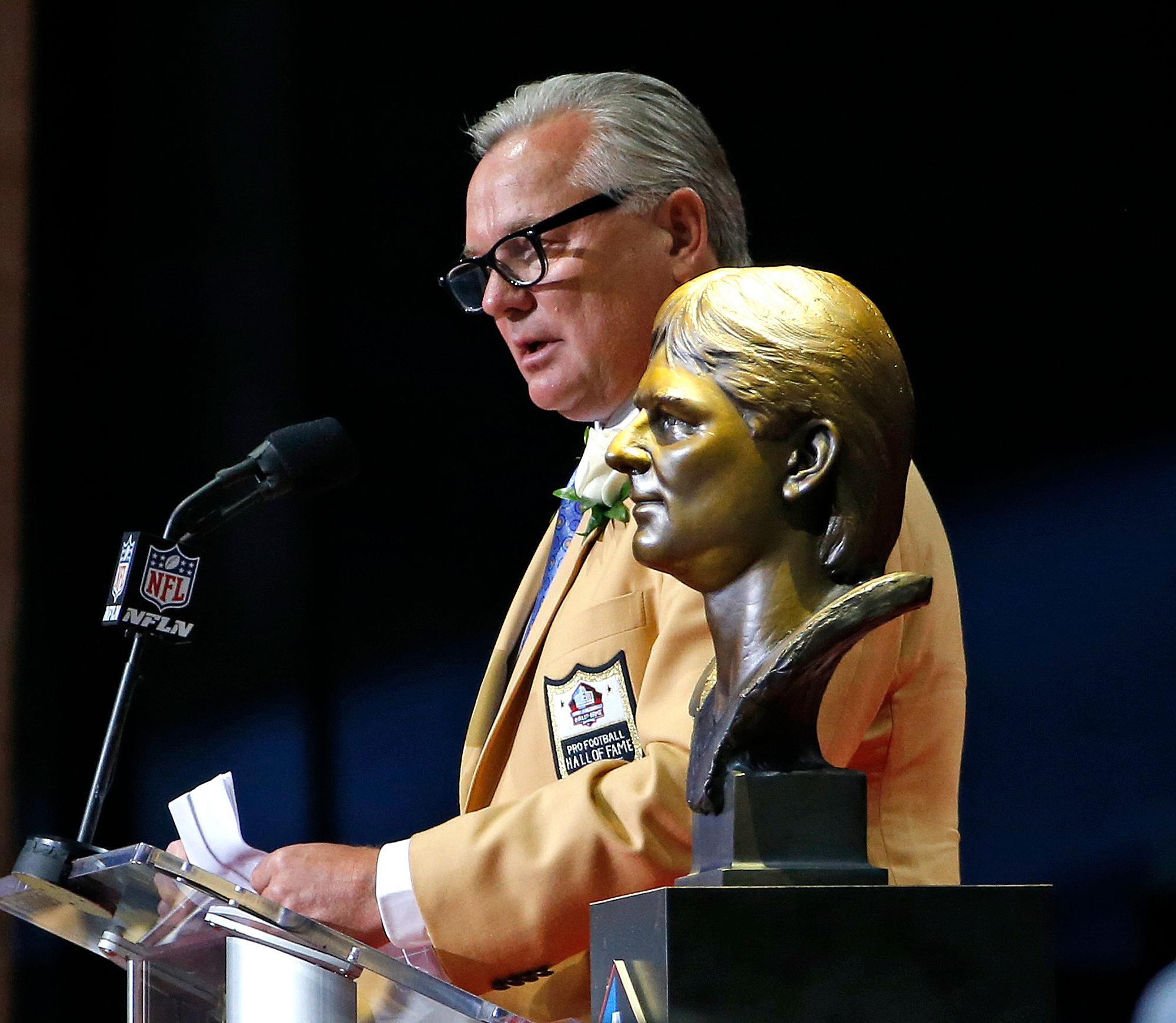 Morten Andersen speaks next to his bust during inductions at the Pro Football Hall of Fame on Saturday, Aug. 5, 2017, in Canton, Ohio. (AP Photo/Ron Schwane)