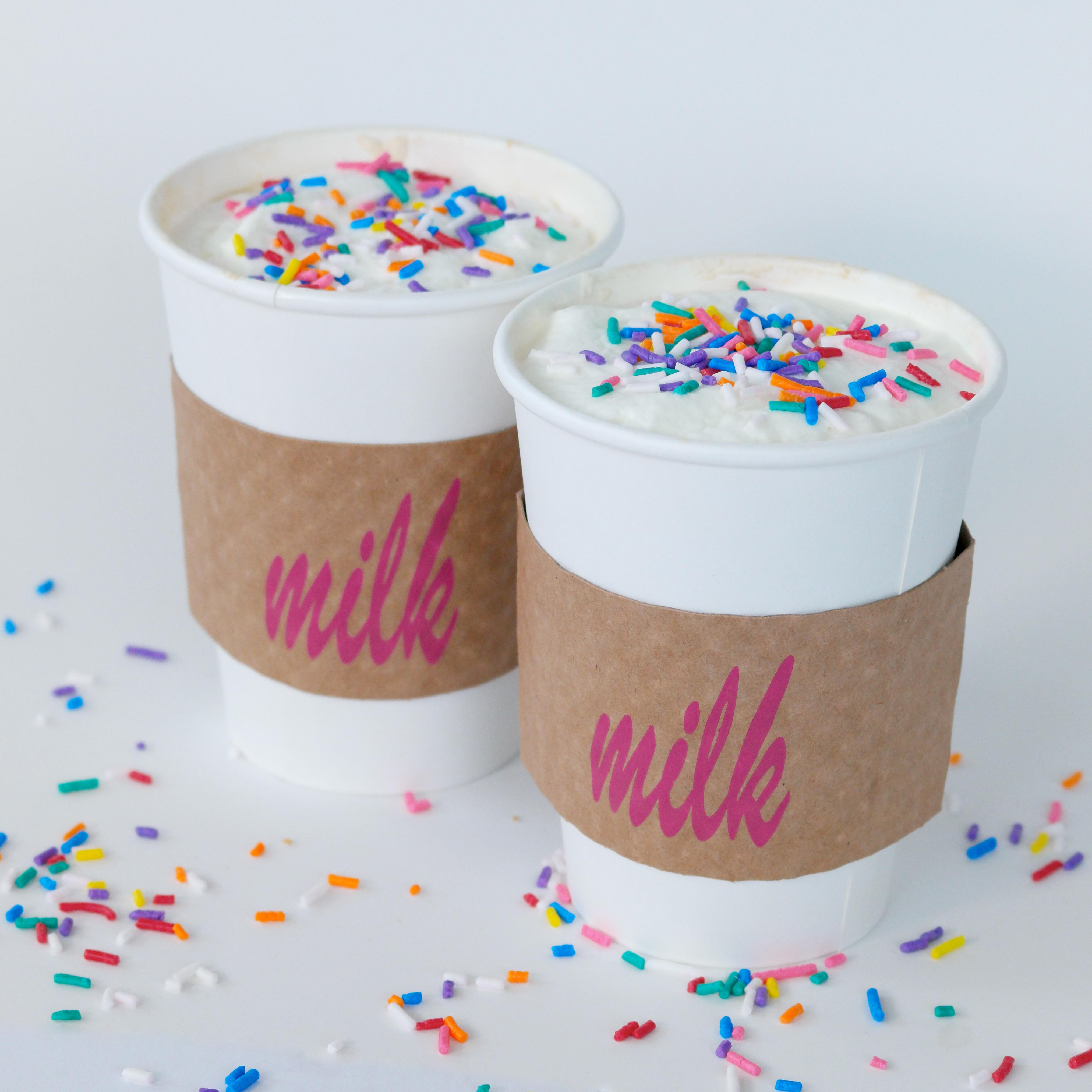 <p>The Cereal Milk Latte is espresso with steamed cereal milk; the Crack Pie Latte is dark brown sugar, corn ganache, espresso and steamed milk; and the B'Day Latte is b'day crumbs, b'day syrup, espresso, steamed Cereal Milk, a dash of salt, yellow cake flavor and sprinkles. (Image: Courtesy Milk Bar)</p><p></p>