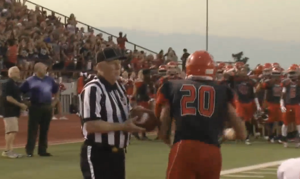 R. T. Sherman hands the ball to a referee after scoring in the Ardmore -Carl Albert game on Friday, Sept. 16, 2016. (KOKH)