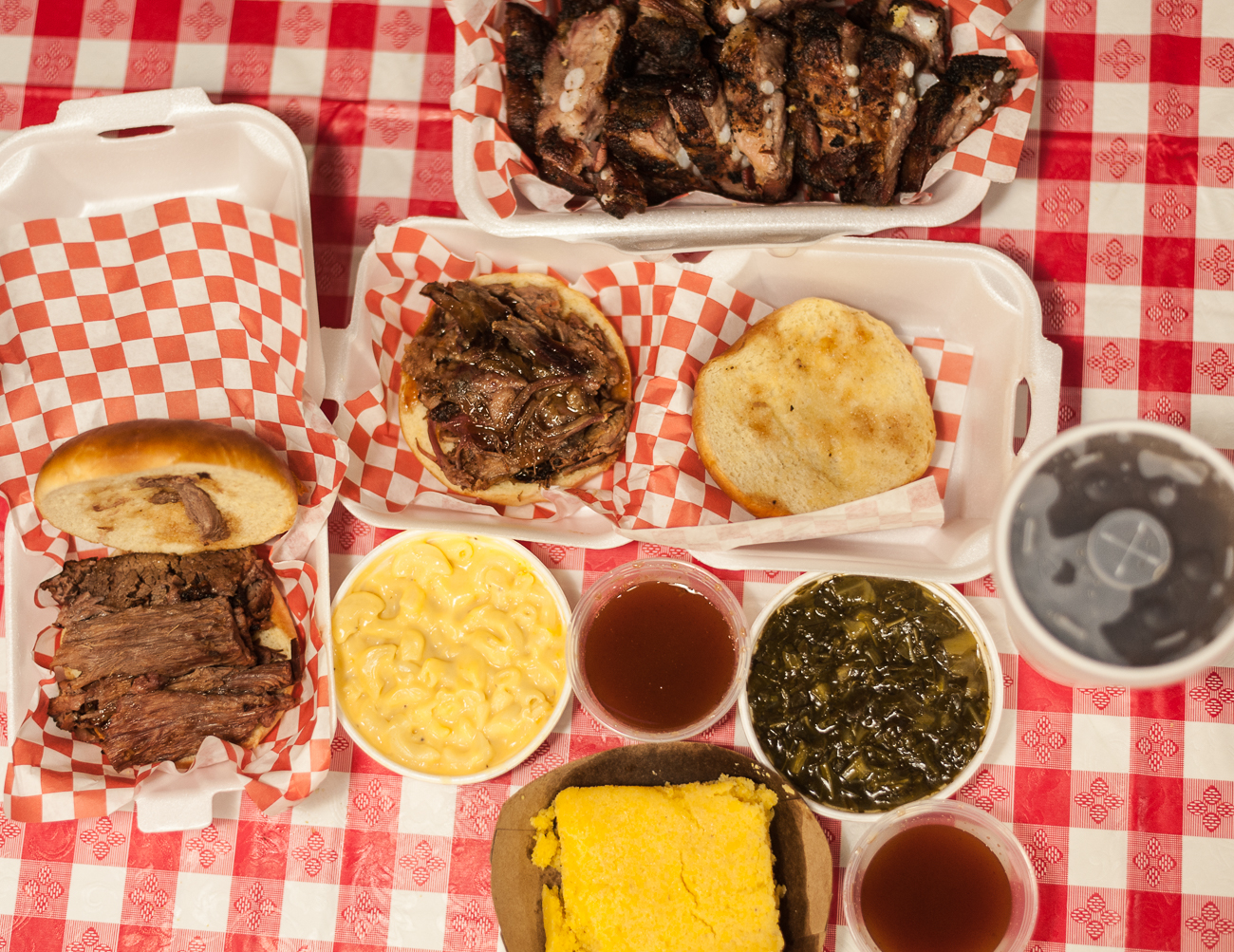 Corn bread, mac & cheese, full brisket sandwich, pulled pork sandwich, rib tips, soft drink, and collard greens / Image: Kellie Coleman // Published: 6.19.20
