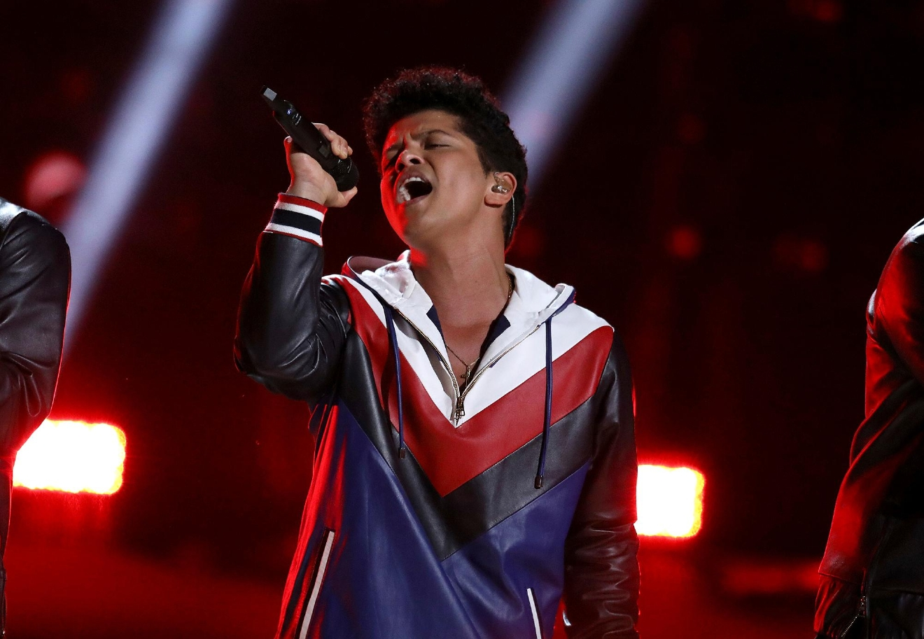 FILE - This Feb. 12, 2017 file photo shows Bruno Mars performing at the 59th annual Grammy Awards in Los Angeles. (Photo by Matt Sayles/Invision/AP, File)