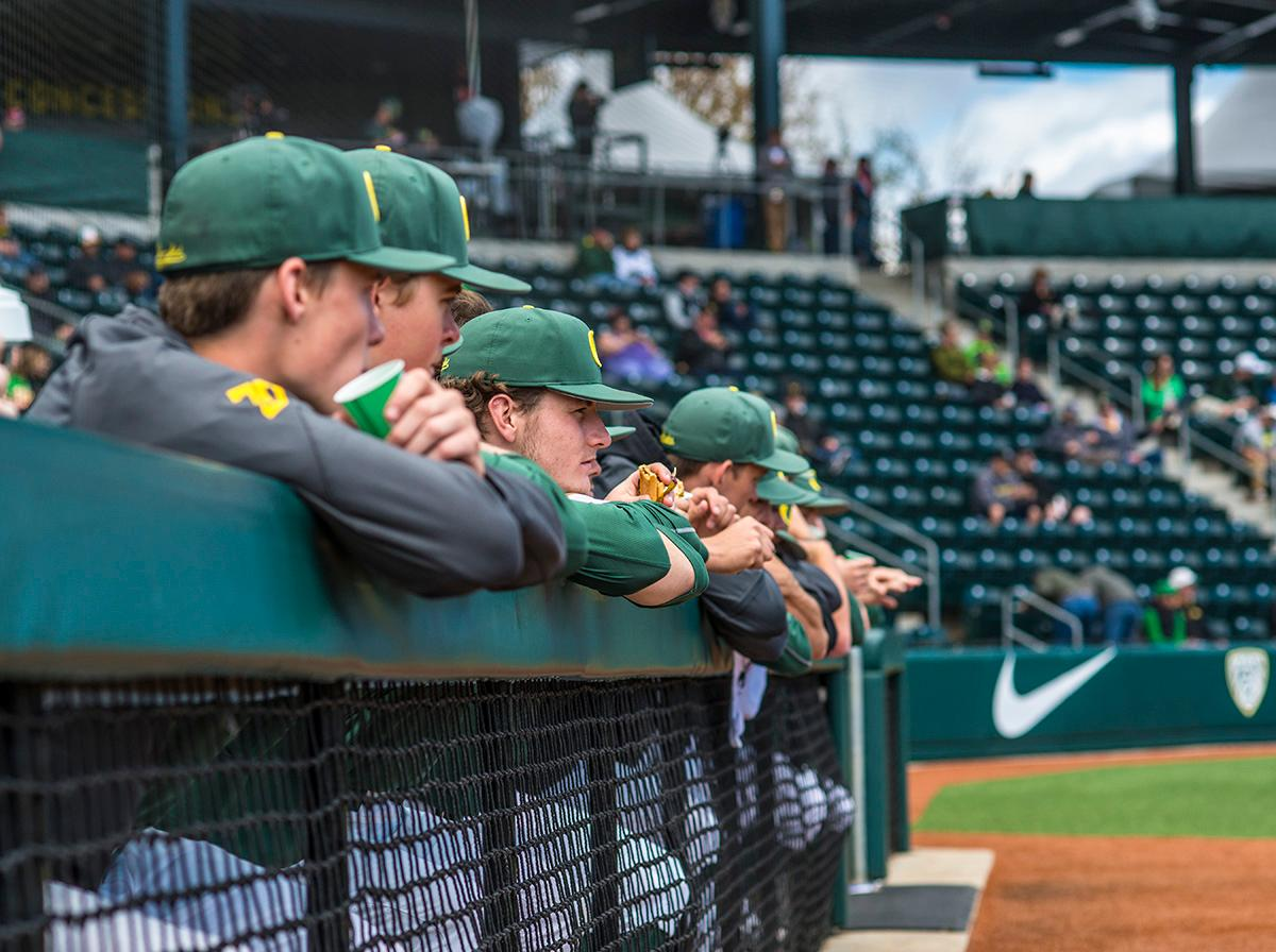 The Oregon Ducks team watches from the dugout. The Oregon Ducks defeated the Arizona State Sun Devils 3-2 on Sunday in the final game of the three-game series to close out with two wins and one loss. Jacob Bennett (#16) gave the Ducks their first point in the third inning. Kyle Kasser (#9) and Morgan McCullough (#1) added two more points in the fourth inning to give the Oregon Ducks enough of a lead to hold off the Sun Devils to the end of the ninth. The Oregon Ducks will play the Oregon State Beavers next in Corvallis, Ore, on May 2 at 5:30 p.m. Photo by Rhianna Gelhart, Oregon News Lab
