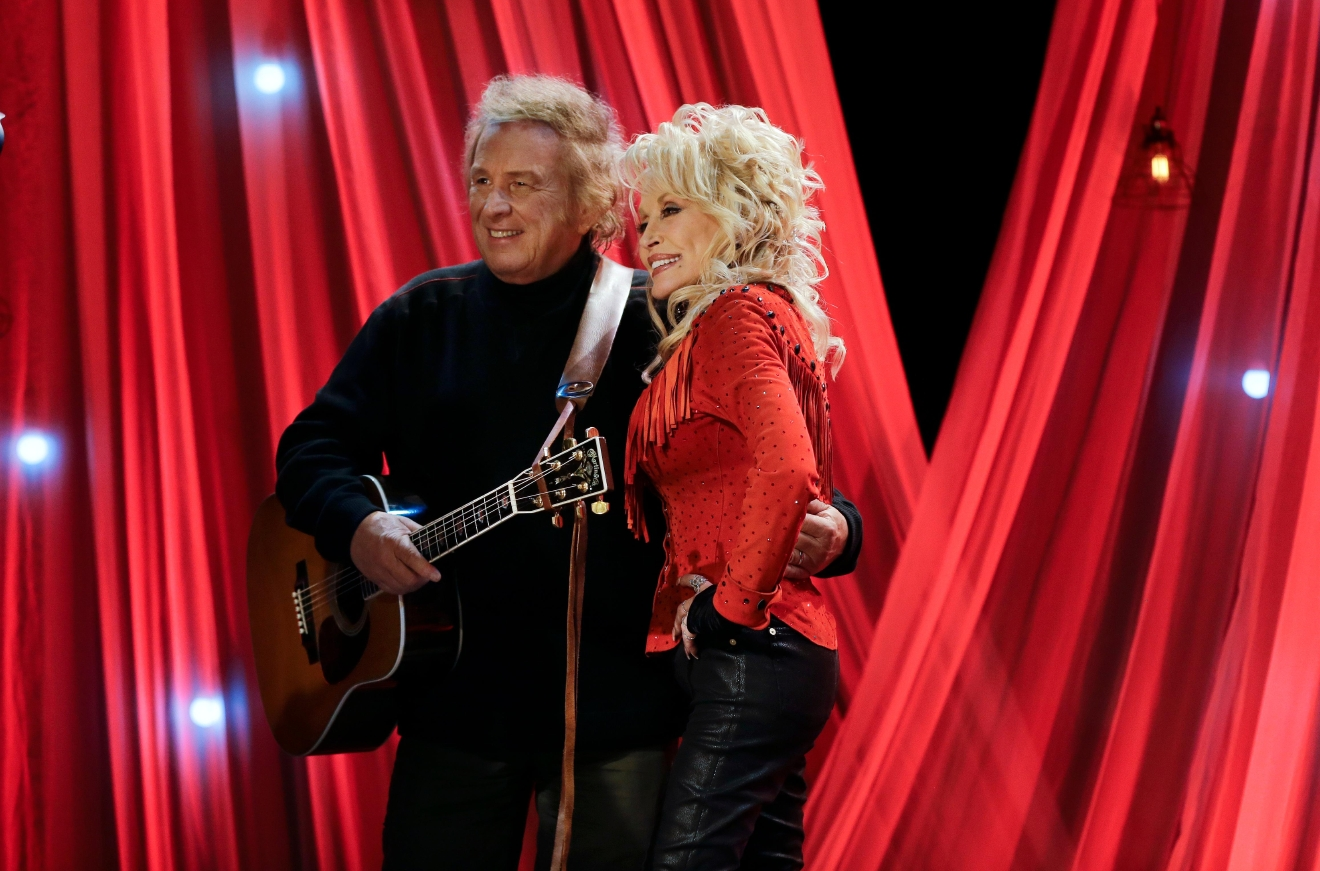 Dolly Parton poses with Don McLean during a taping for Dolly Parton's Smoky Mountain Rise Telethon Tuesday, Dec. 13, 2016, in Nashville, Tenn. Parton has lined up an all-star list of performers for a three-hour telethon to raise money for thousands of people whose homes were damaged or destroyed in Tennessee wildfires. (AP Photo/Mark Humphrey)
