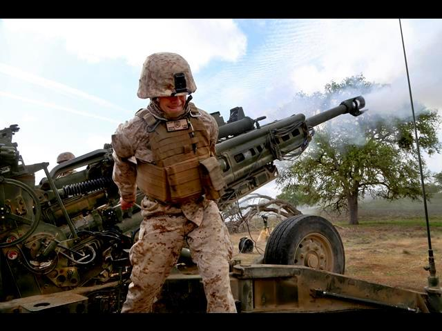 Marine Corps Sgt. Joseph Reed Jr., fires his first M777A2 howitzer round as part of a tactical exercise during Realistic Urban Training Marine Expeditionary Unit Exercise 14-1 on Fort Hunter Liggett, Calif., March 26, 2014.