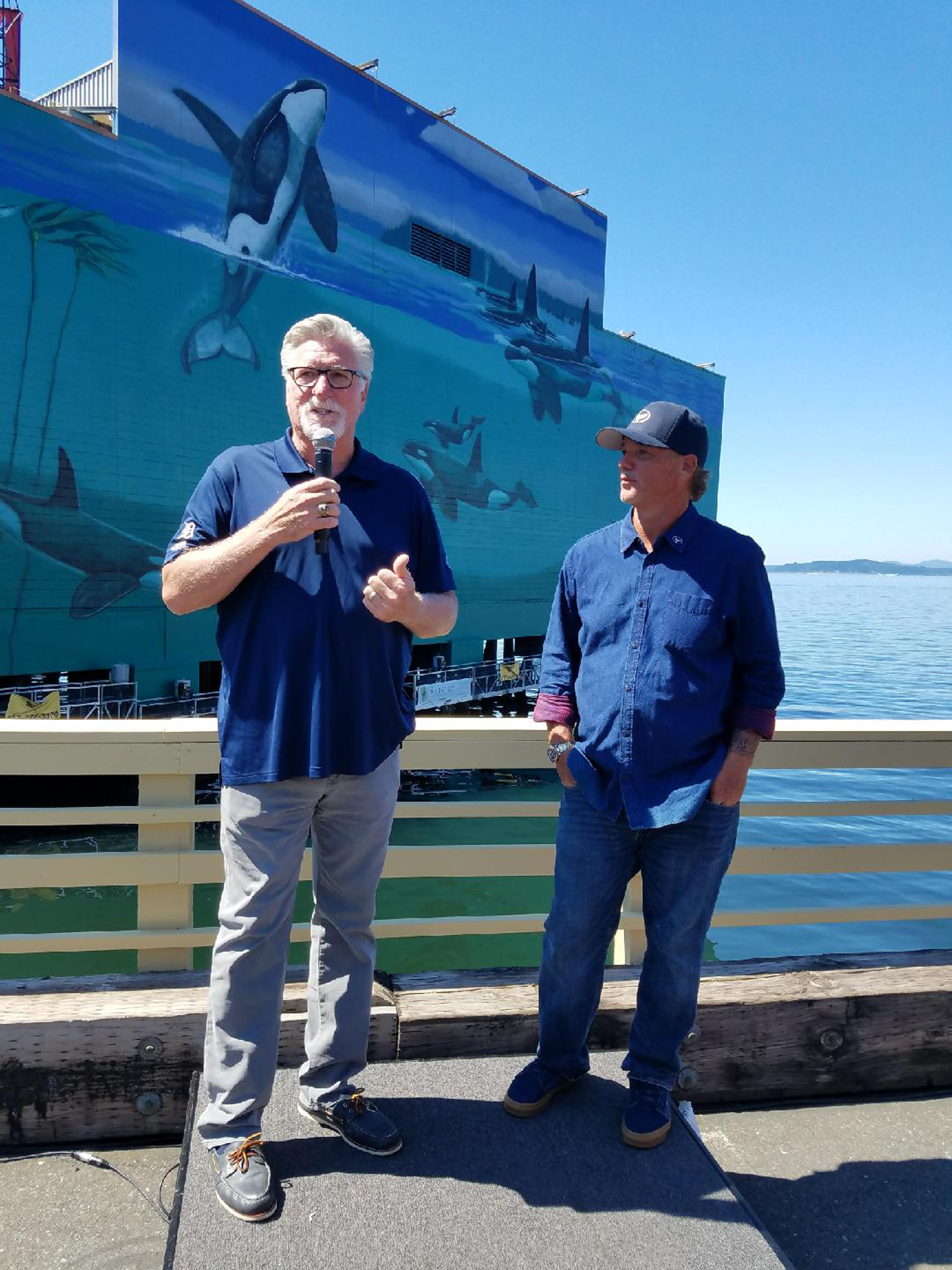 "The Edgewater Hotel{ }partnered with acclaimed artist and conservationist,{ }Wyland, to ""recreate his special landmark in the Emerald City."" His special land mark is his famous ""Whaling Wall"" murals, with over 100 life-size whale murals that have popped up around the world over a 27-year period. Wyland paints these murals to bring awareness to the state of our oceans and to celebrate his global efforts for clean water and healthy oceans for all species. He had been working on this mural from July 23-27, 2019. Be sure to head down to the Edgewater to get a sneak peek of this amazing mural! (Image courtesy of Gary Firstenberg)."