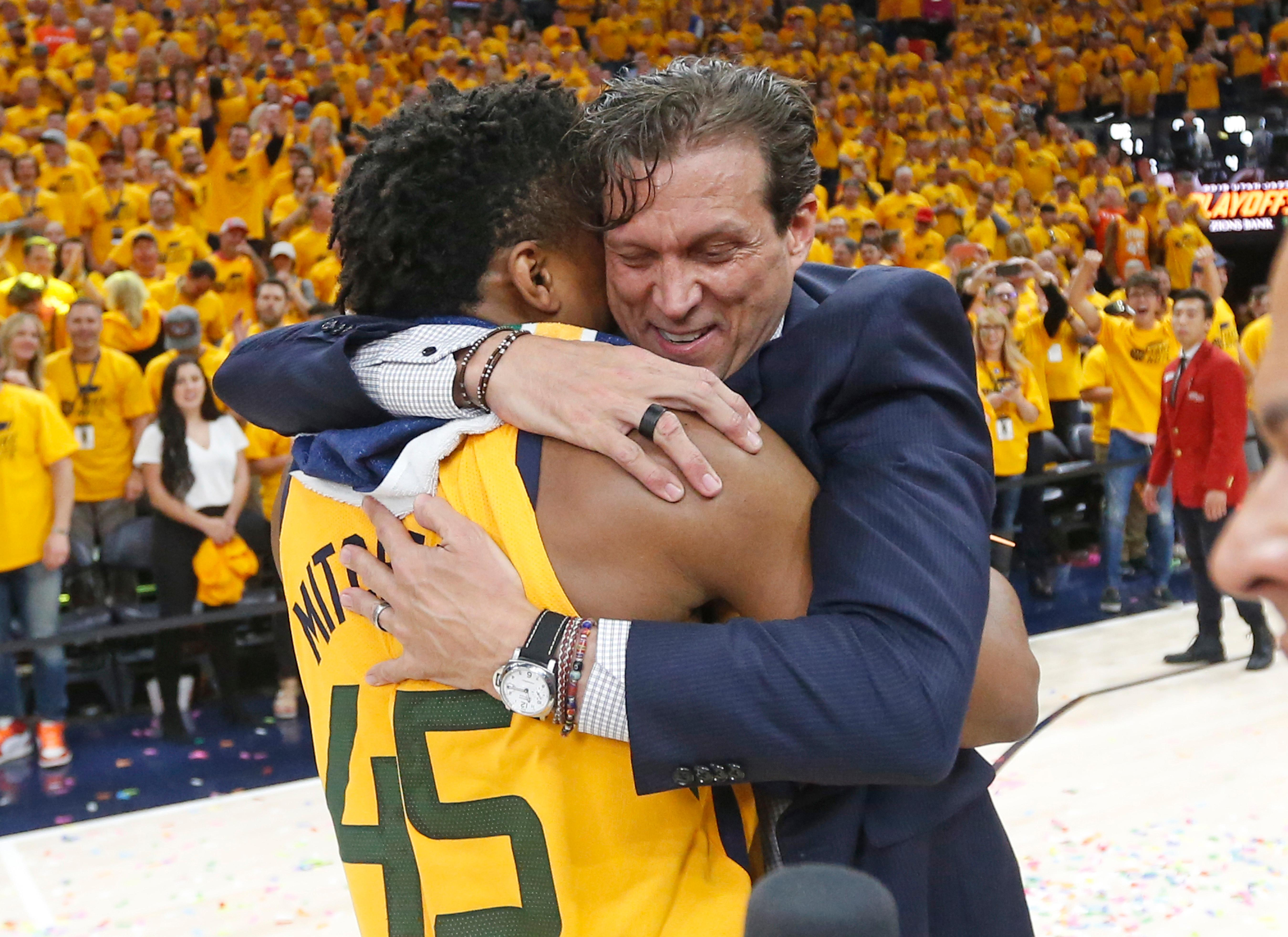 Utah Jazz coach Quin Snyder hugs guard Donovan Mitchell (45) after the team's 96-91 victory over the Oklahoma City Thunder during Game 6 of an NBA basketball first-round playoff series Friday, April 27, 2018, in Salt Lake City. The Jazz won the series. (AP Photo/Rick Bowmer)