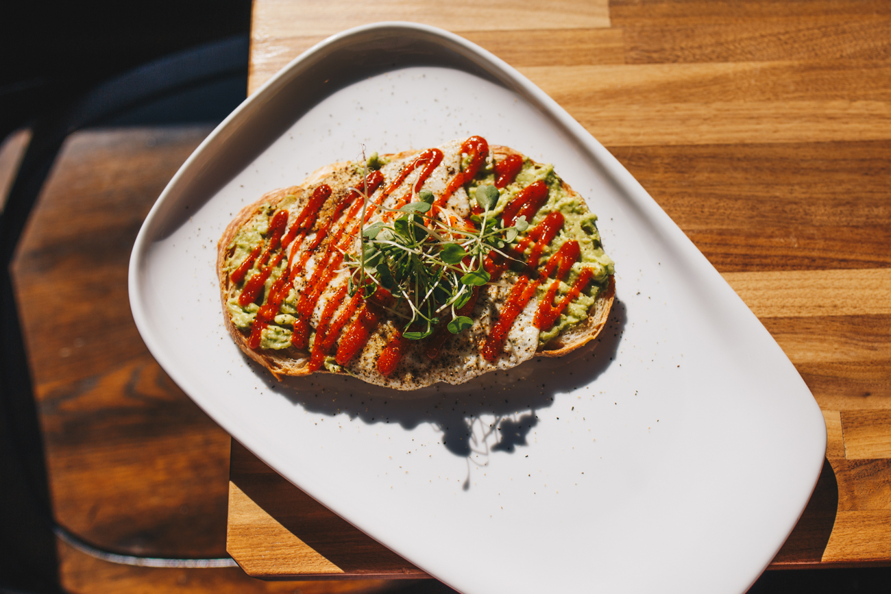 Avocado toast: thick-sliced sourdough, smashed avocado, pickled red onion, salt, pepper, and topped with sriracha{ }/ Image: Catherine Viox // Published: 11.15.18