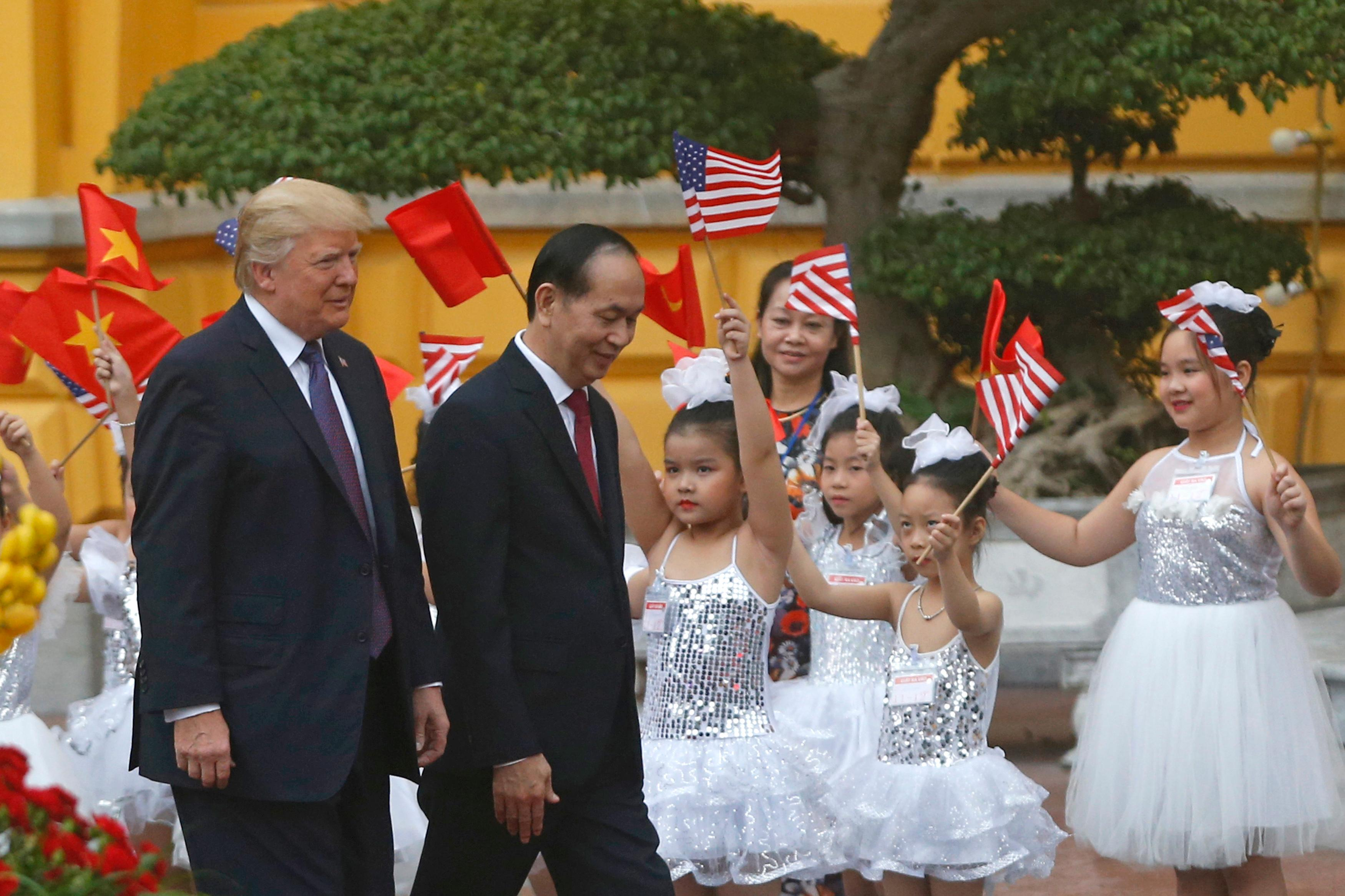 U.S. President Donald Trump, left,  and Vietnam's President Tran Dai Quang attend the welcoming ceremony at the Presidential Palace in Hanoi, Vietnam Sunday, Nov. 12, 2017. (Kham/Pool Photo via AP)