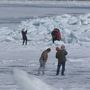Blue ice in Mackinaw City draws thousands, police warn to stay on shore