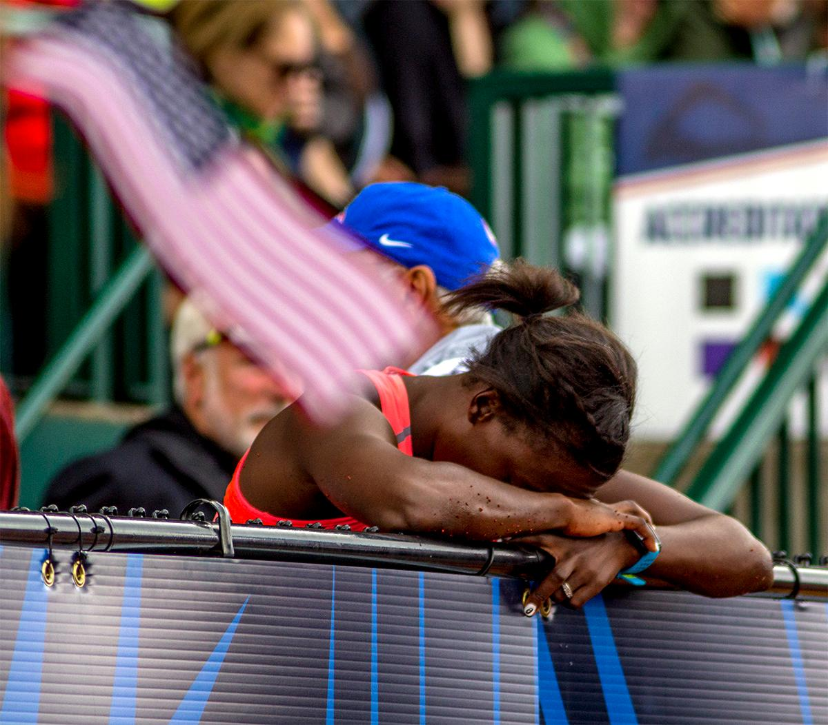 Asic's Sharon Day-Monroe takes a moment to rest after finishing second in the 800 meter portion of the heptathlon and fourth overall. Photo by August Frank, Oregon News Lab