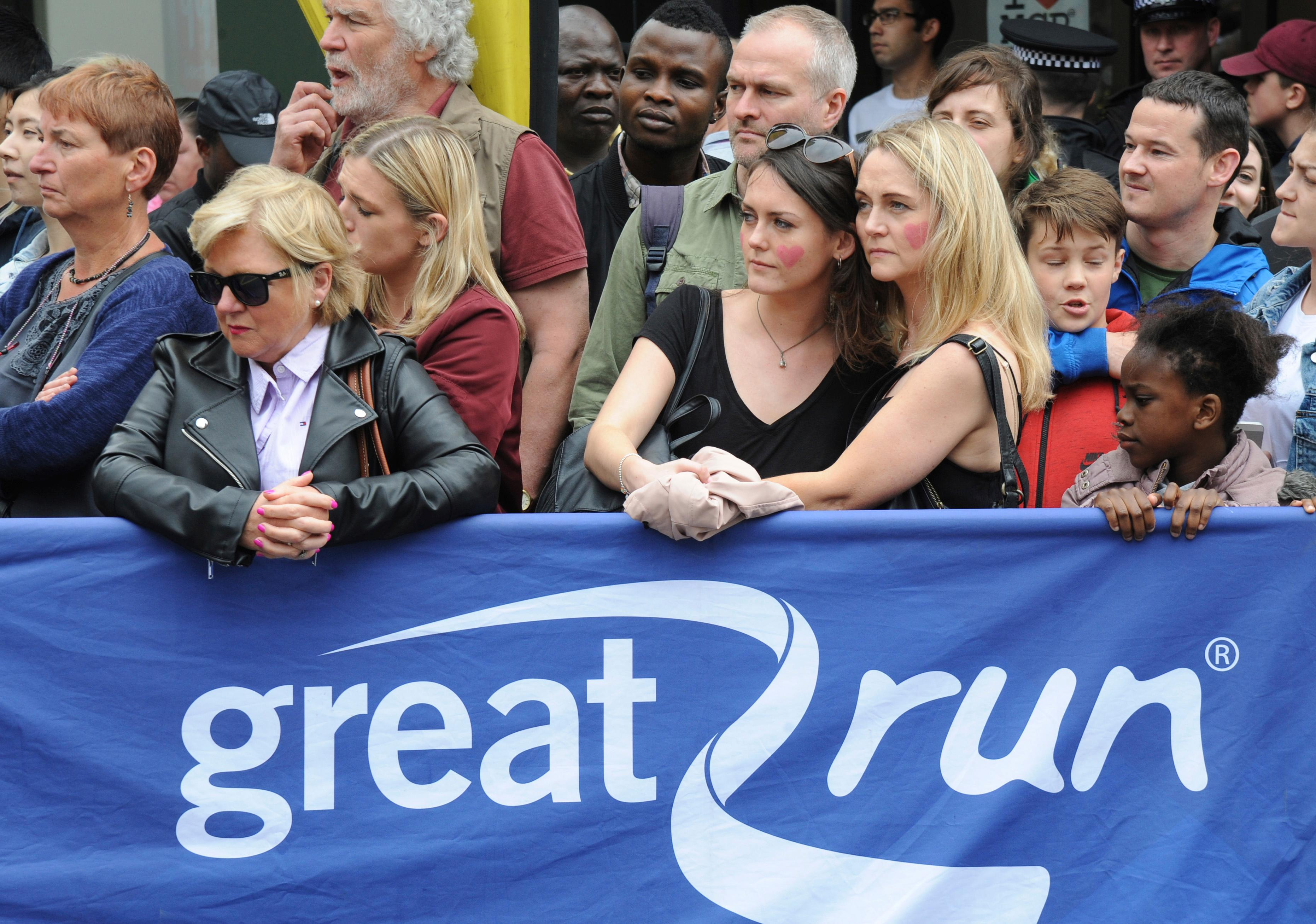 People wait for the start of the Great Manchester Run in central Manchester, England Sunday May 28 2017. More than 20 people were killed in an explosion following a Ariana Grande concert at the Manchester Arena late Monday evening. (AP Photo/Rui Vieira)