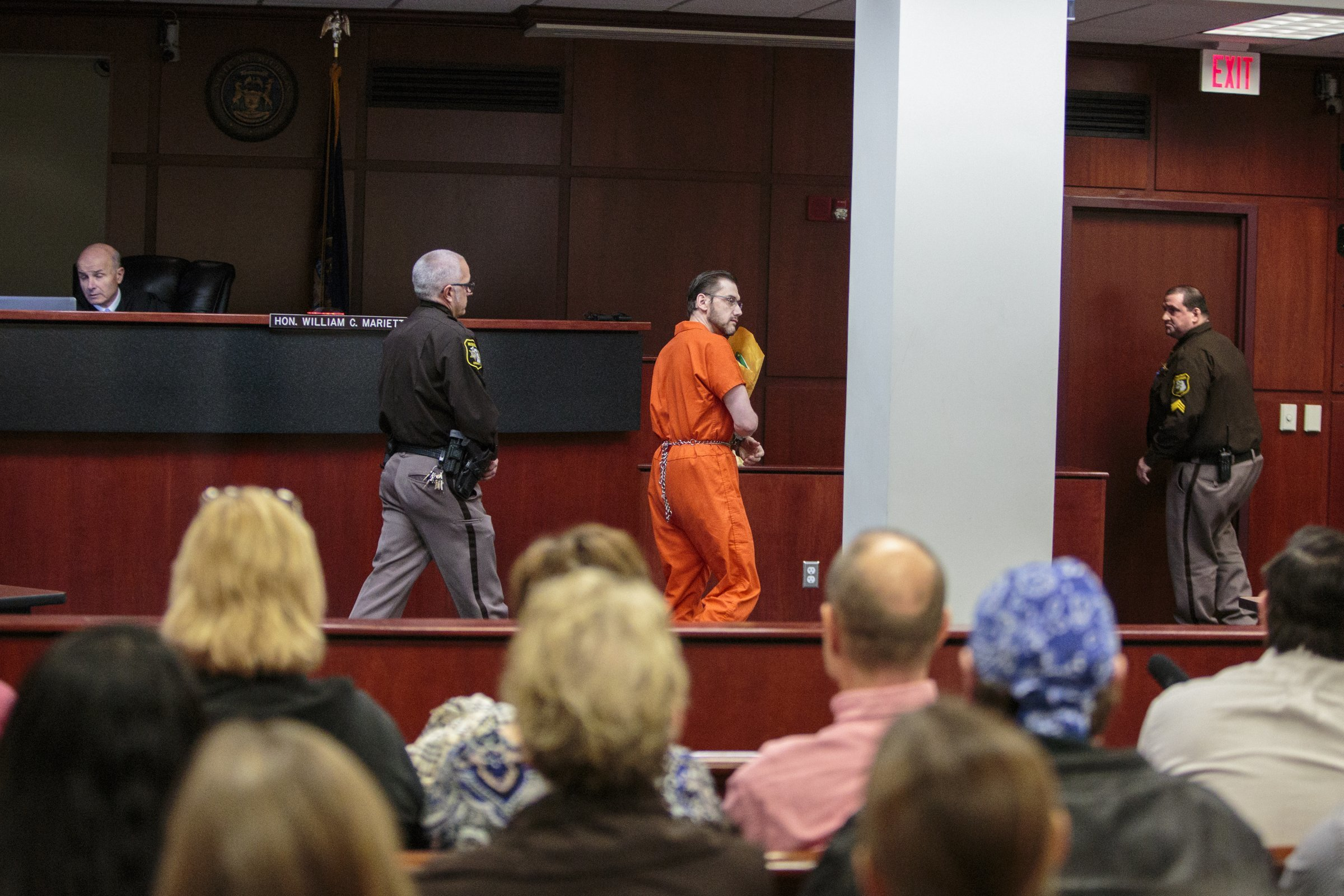 Jeffrey Willis exits the court room Monday, Dec. 18, 2017, before his sentencing in front of Judge William Marietti for the first degree murder in June 2014 of Rebekah Bletsch in Muskegon, Muskegon County Court House. Willis decided he would leave the courtroom before he was sentenced to a mandatory life sentence without chance of parole. (Joel Bissell/Muskegon Chronicle via AP)