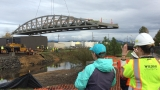 Pedestrian bridge goes up across Amazon Creek in west Eugene