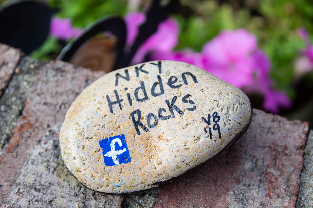 Jo suggests people reference the NKY Hidden Rocks Facebook page on the back of the rock to direct people to the group. She also reminds members to cover their completed rocks in a sealant to protect them from the elements outdoors. The rocks should be hidden in safe places to retrieve, such as a park or outside a business where people will see them. / Image: Katie Robinson, Cincinnati Refined // Published: 8.17.19