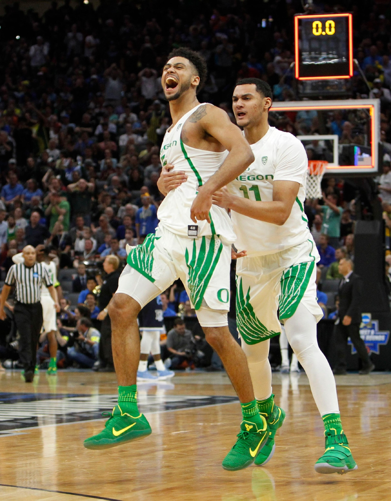 Oregon guard Tyler Dorsey (5) celebrates with teammate Keith Smith (11) after their win over Rhode Island during a second-round game in the NCAA college basketball tournament in Sacramento, Calif., Sunday, March 19, 2017. Oregon won 75-72. (AP Photo/Steve Yeater)