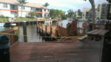 13 people pulled from water after dock collapses at Boca Bayou Condominiums