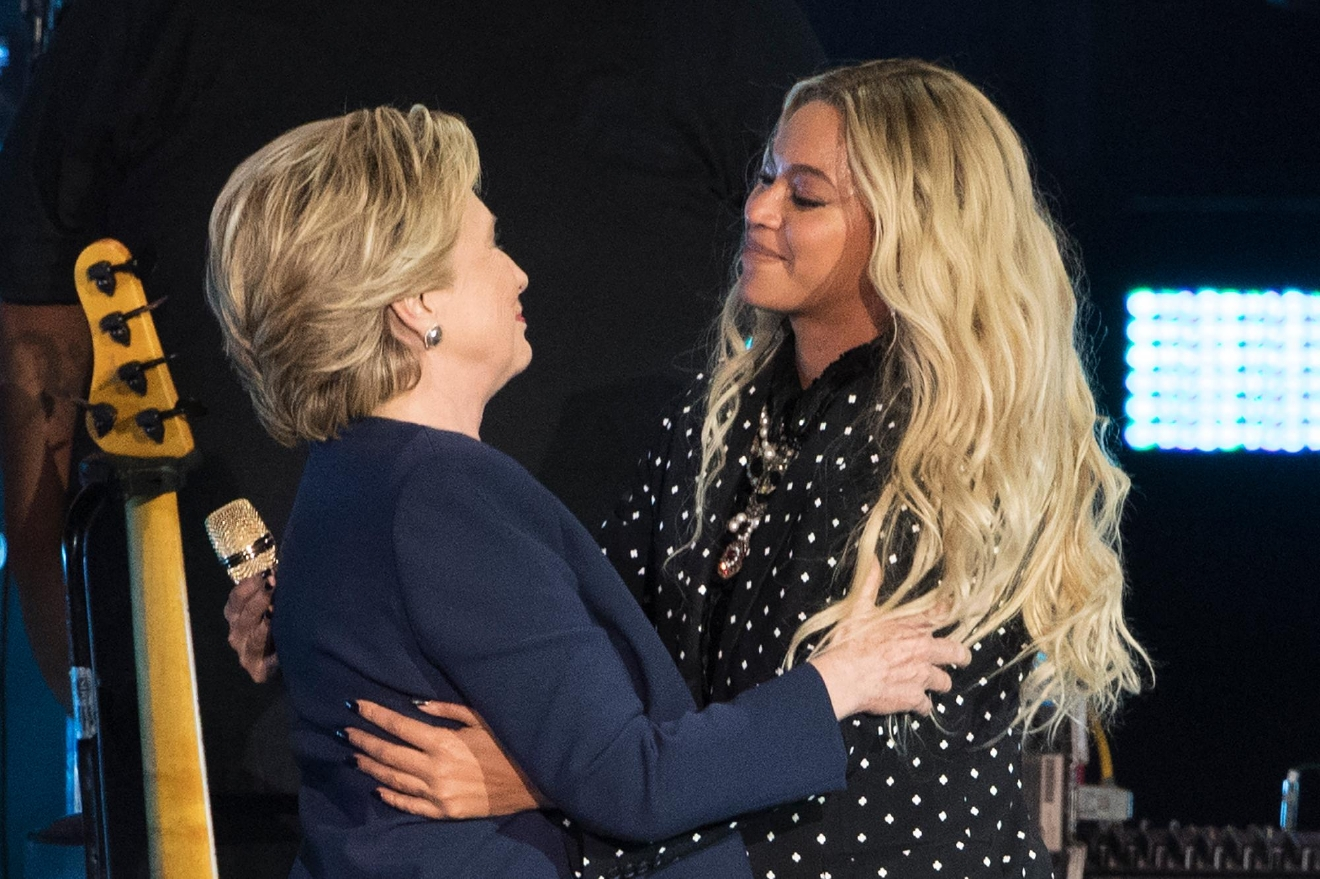Beyonce, right, and Democratic presidential candidate Hillary Clinton embrace during a campaign rally in Cleveland, Friday, Nov. 4, 2016. (AP Photo/Matt Rourke)