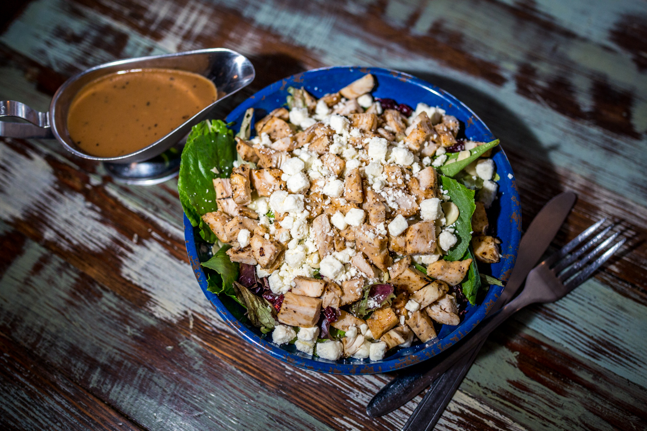 The Green Kayak Salad: spring greens with chicken, almonds, feta, and balsamic dressing / Image: Catherine Viox // Published: 9.1.19
