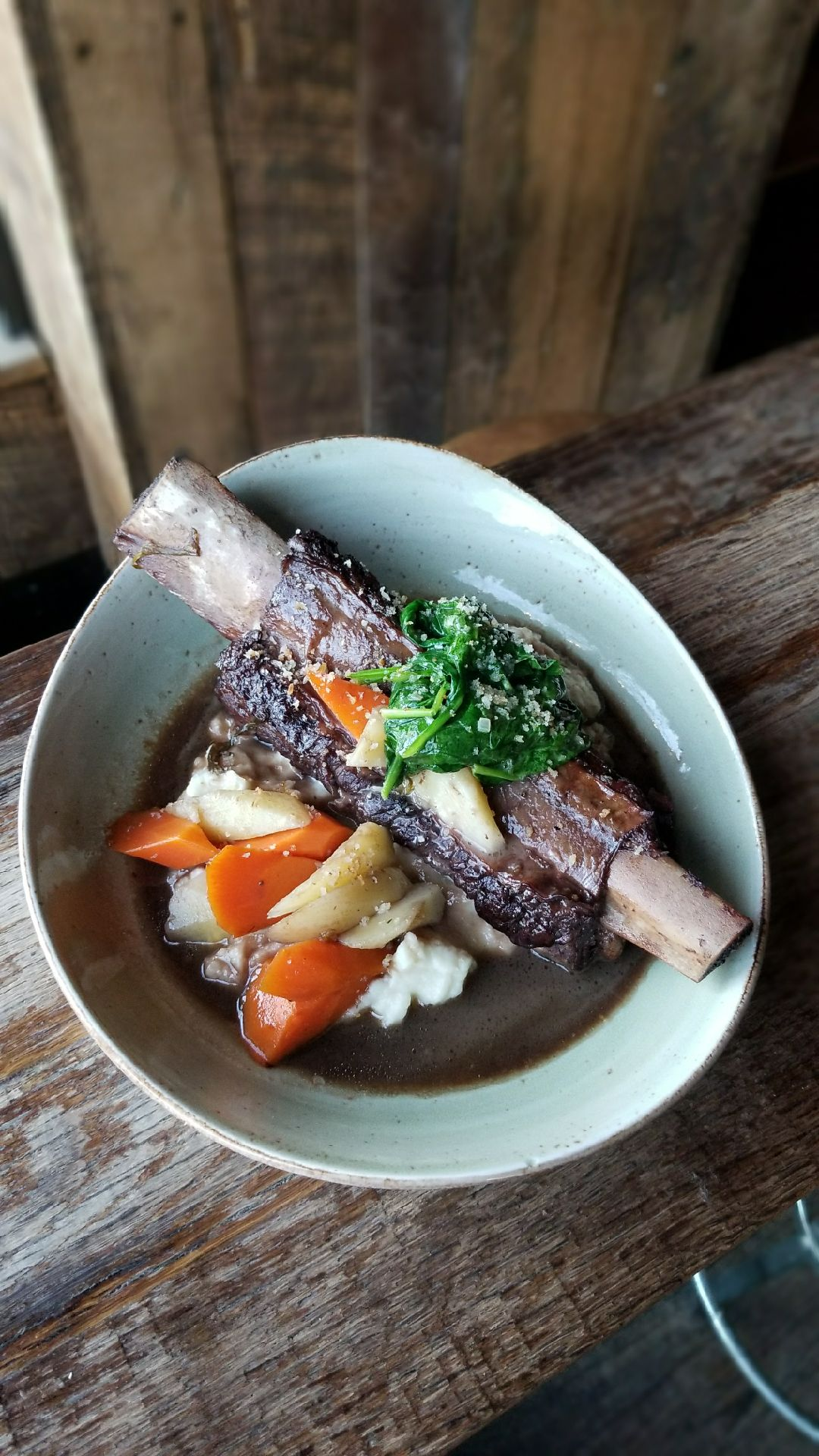 Braised Short Rib with Red Wine Au Jus, Celery Root Puree, Carrots, Parsnips, Greens and Gremolata (Photo courtesy: Barrel)<p></p>