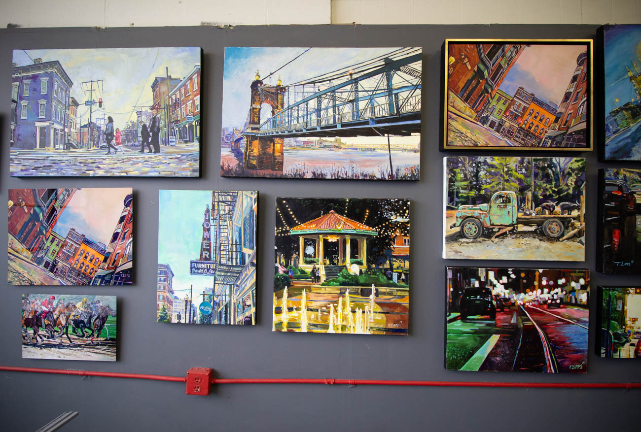 Tony Lipps is a local alum of Moeller High School and Kent State University who returned to Cincinnati to pursue a career in fine art. Before becoming a full-time painter though, he served as a police officer in the Hamilton County Sheriff's Department out of college for 13 years. He officially began his art career in early 2019, blending photo realism and abstract styles in his vibrant portraits of Cincinnati cityscapes and sports scenes. / Image: Katie Robinson, Cincinnati Refined // Published: 2.16.20