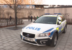 Police stationed outside Vårby gård metro station.png