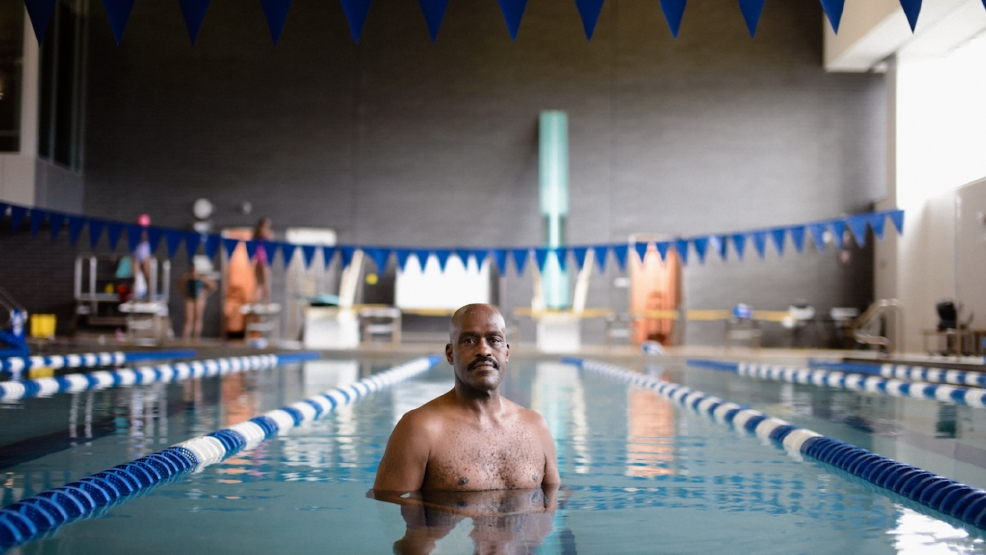 Fred Evans has coached swimming in Chicago for more than 40 years. (Photo courtesy Luke White/South Side Weekly)