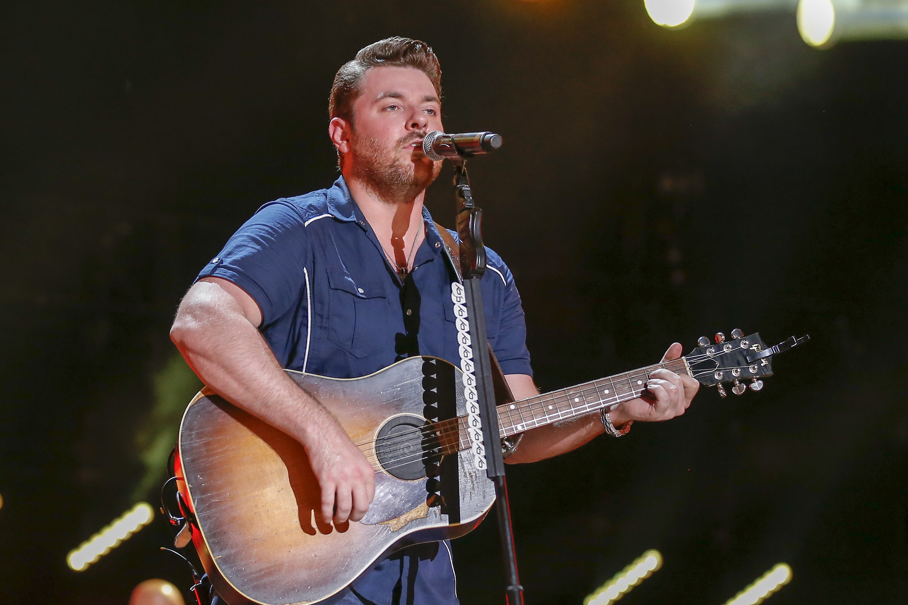 FILE - In this Saturday, June 11, 2016, file photo, Chris Young performs at the CMA Music Festival at Nissan Stadium in Nashville, Tenn. Young is donating $100,000 for disaster relief efforts in Texas. Nashville-based Monarch Publicity said in a news release that Young lived in Arlington, Texas, before signing with RCA records and has family and close friends in Hurricane Harvey's path. (Photo by Al Wagner/Invision/AP, File)