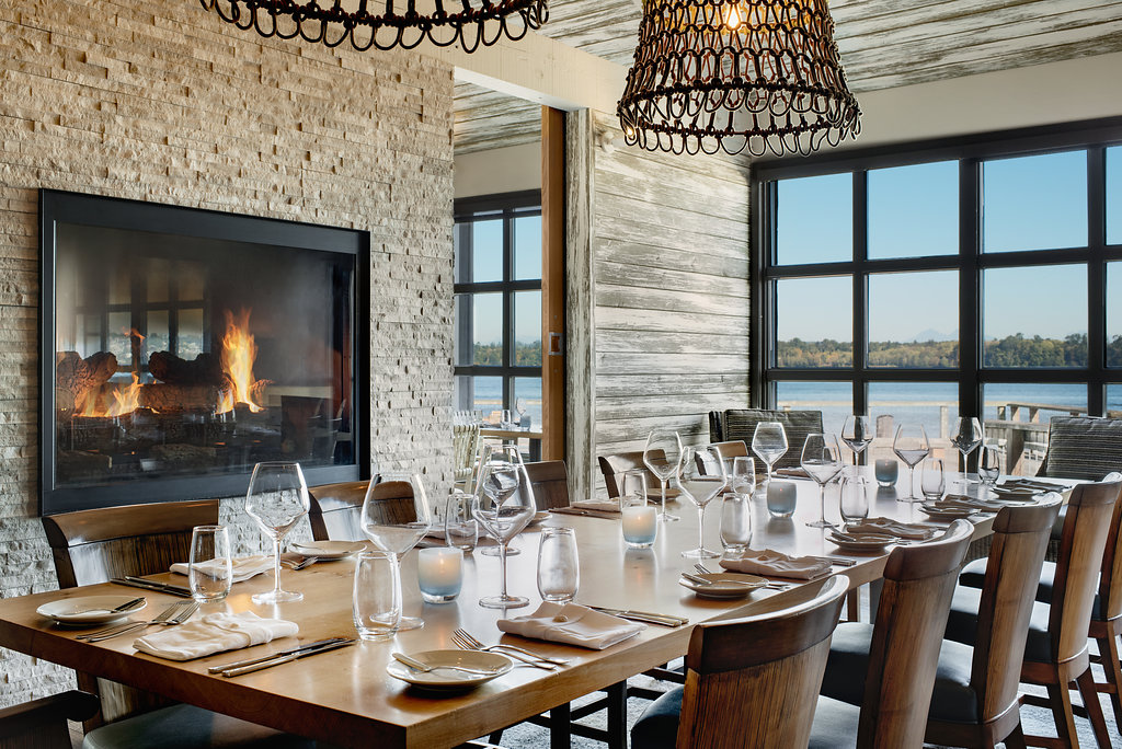 The private dining room inside Pierside Kitchen is beautifully designed with a cozy fireplace and breathtaking views of Drayton Harbor. (Image by KIPMAN Creative)<p></p>