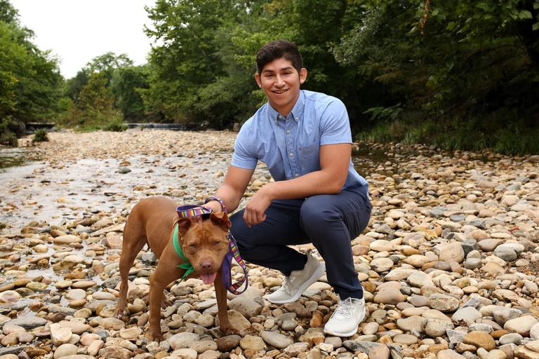 Brandon is a 21-year-old bartender/student who enjoys sports, hiking, and backpacking.// Amanda is a 2-3 year old American Staffordshire Terrier. She is available for adoption from Lucky Dog Animal Rescue.  (Amanda Andrade-Rhoades/DC Refined)