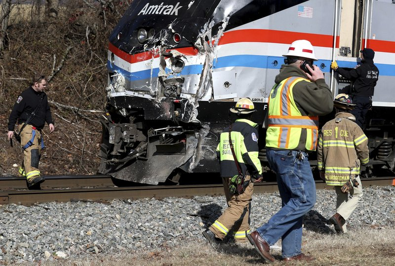 <p>Emergency personnel inspect the lead engine of an Amtrak train that was carrying multiple Republican lawmakers that crashed into a garbage truck in Crozet, Va., on Wednesday, Jan. 31, 2018. A chartered train carrying dozens of GOP lawmakers to a Republican policy retreat in West Virginia struck a garbage truck in a rural Virginia town Wednesday. (Zack Wajsgras/The Daily Progress via AP)</p>