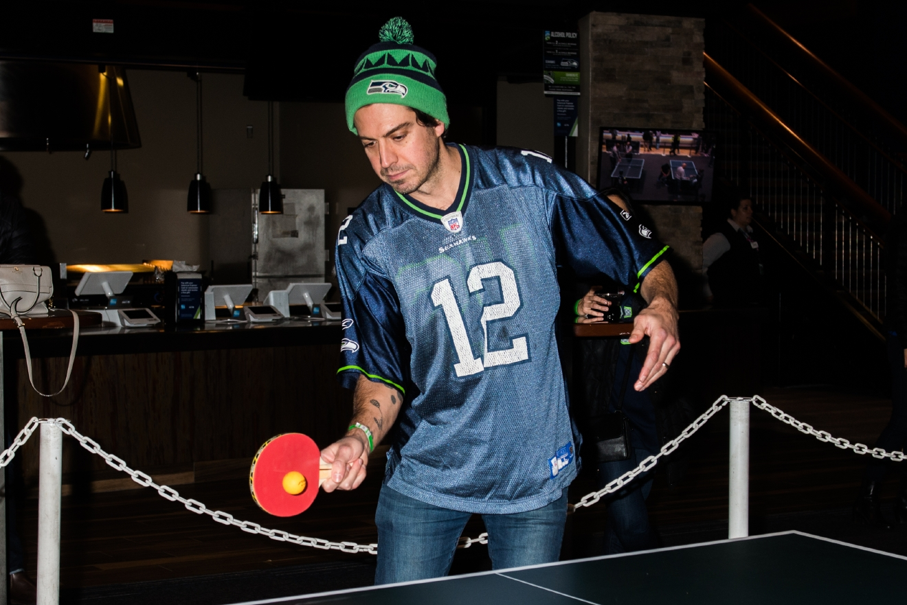 Monday night, Seahawks, Huskies and Sounders gathered at CenturyLink Field to play a game. No, not football, basketball or soccer - this game had a much much smaller ball. Ping Pong! That's right, it was the annual Steven Hauschka Celebrity Ping Pong Tournament, and Hausch brought out a bunch of his friends to participate. Fans who paid $1,200 got to play in the semi-finals for a chance to go against Hauschka, while other just paid the general $25 admission fee or $100/$150 to play a celebrity for fun. Proceeds from the event benefit Mary's Place, specifically towards creating a crisis-response winter night shelter as part of the No Child Sleeps Outside campaign. (Image: Chona Kasinger / Seattle Refined)