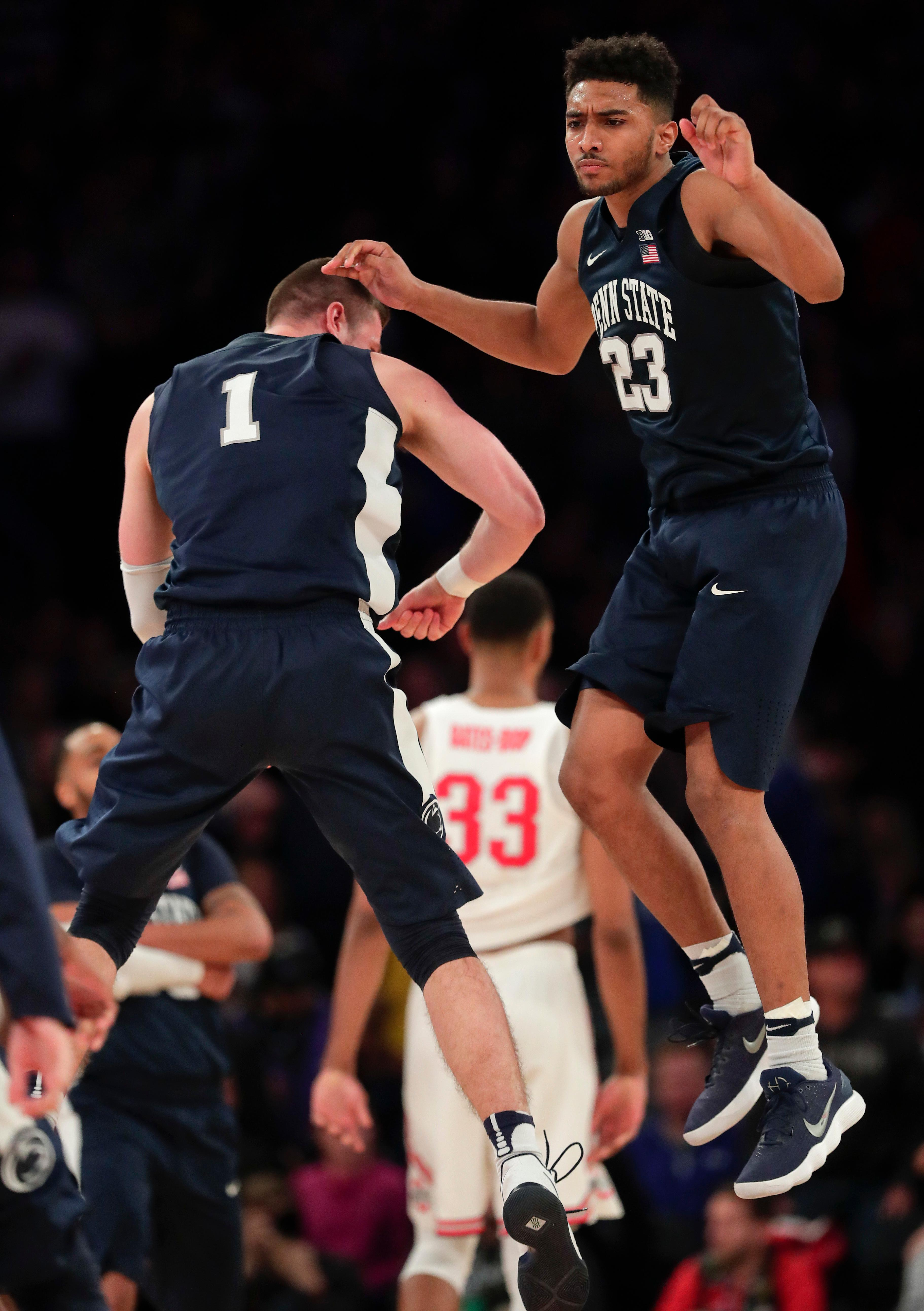 Penn State guard Josh Reaves (23) celebrates with forward Deividas Zemgulis (1) after Penn State beat Ohio State 69-68 in an NCAA Big Ten Conference tournament college basketball game, Friday, March 2, 2018, in New York. (AP Photo/Julie Jacobson)
