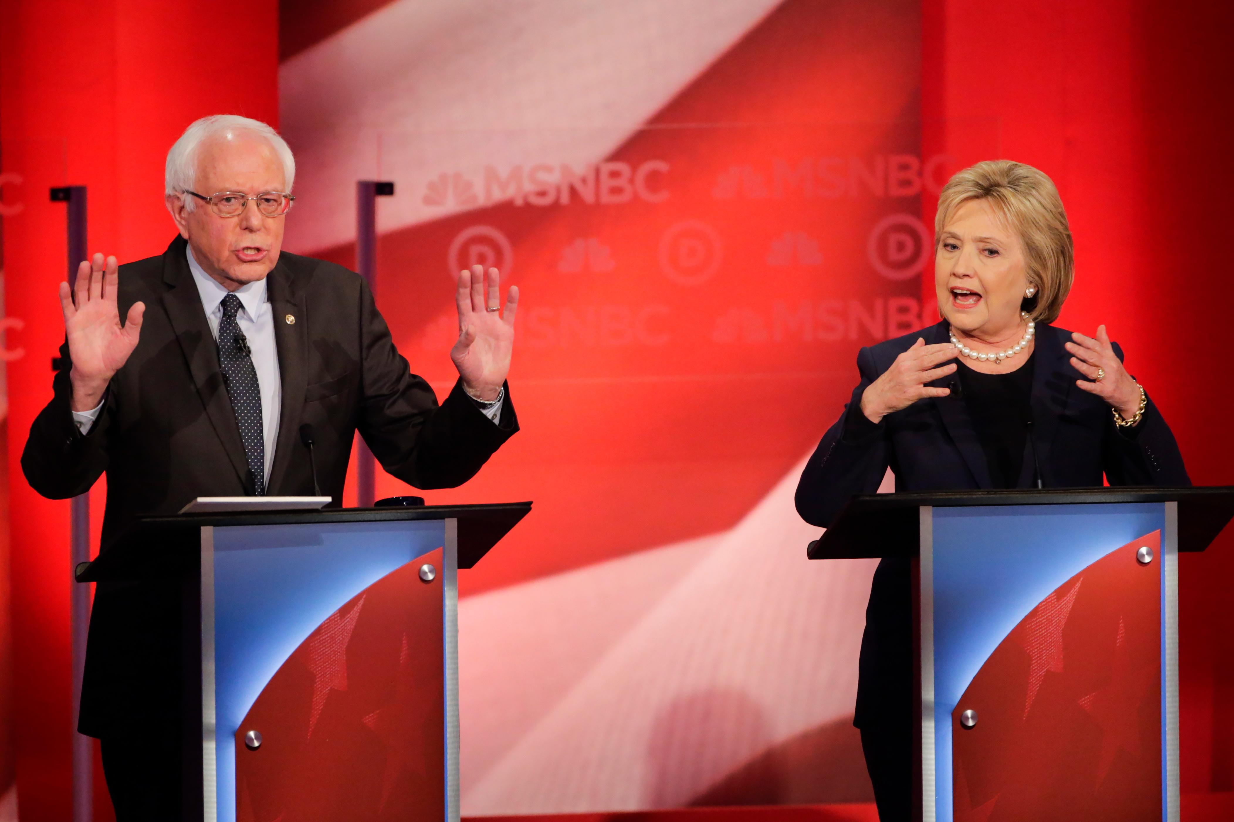 Democratic presidential candidate, Sen. Bernie Sanders, I-Vt,  and Democratic presidential candidate, Hillary Clinton spar during a Democratic presidential primary debate hosted by MSNBC at the University of New Hampshire Thursday, Feb. 4, 2016, in Durham, N.H. (AP Photo/David Goldman)