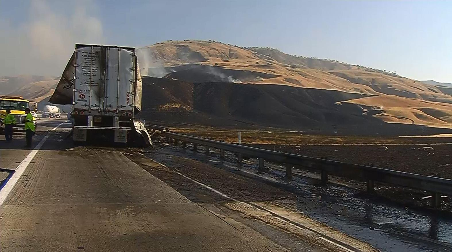 The results of a fiery crash involving two big rigs on southbound Interstate 5 at the base of the Grapevine are seen Thursday, Aug. 10, 2017. (KBAK/KBFX photo)