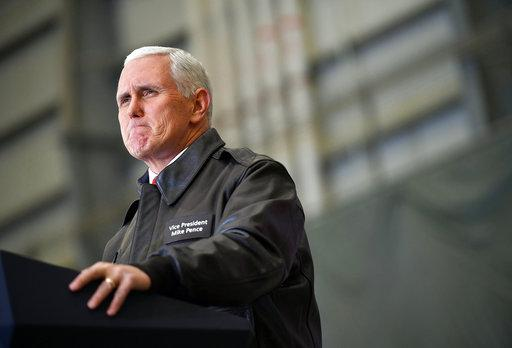 U.S. Vice President Mike Pence speaks to troops in a hangar at Bagram Air Base in Afghanistan on Thursday, Dec. 21, 2017. Mandel Ngan/Pool via AP)