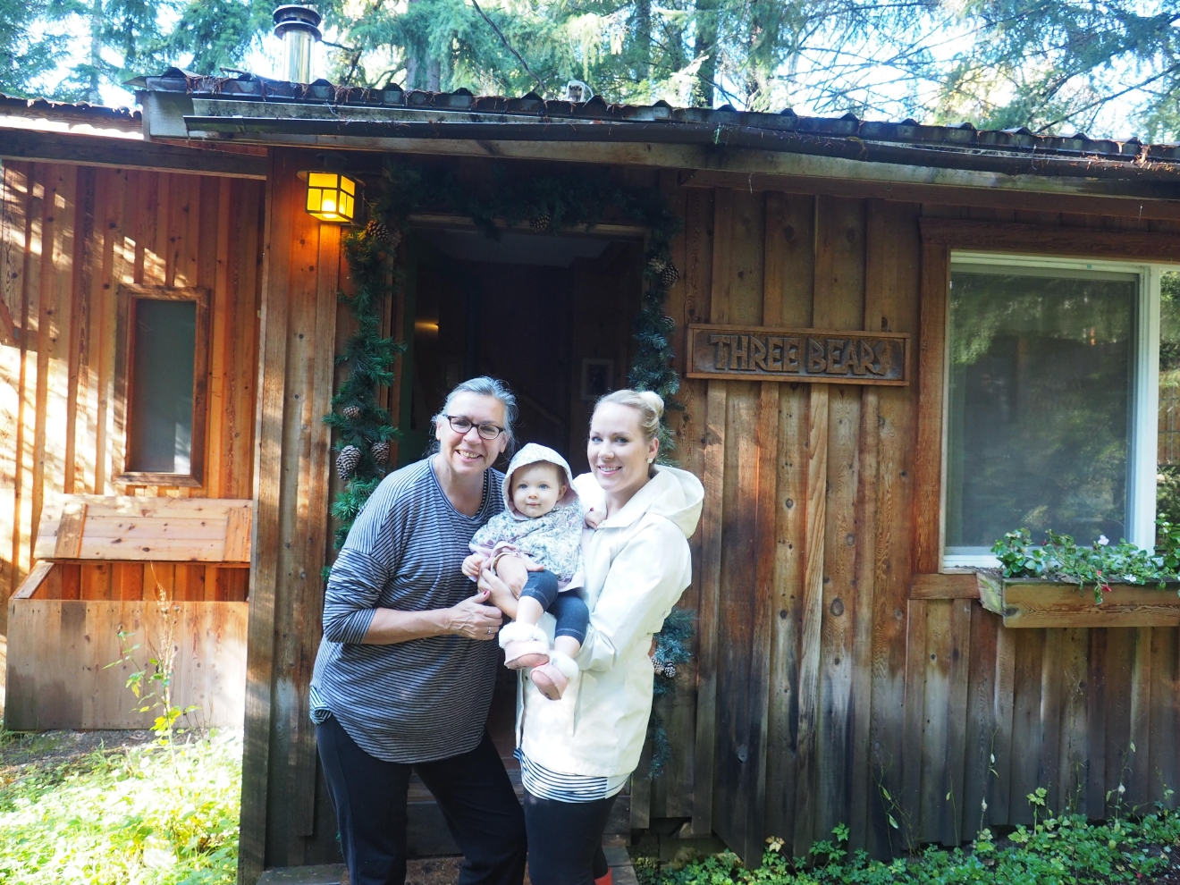 Two moms and a baby and Wellspringspa in front of the 3 Bears Cottage.  It's un-BEARably cute! (Image: Kate Neidigh/Seattle Refined)