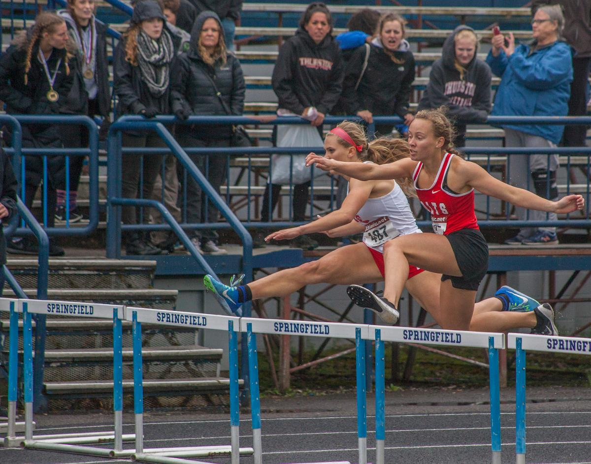 Tara Crosswhite from Thurston High School wins the Women's 100m Hurdles event with the time of 45.68 at the 5A-3 Midwestern League District Track Championship. Photo by Vannie Cooper, Oregon News Lab